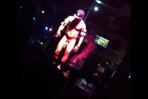 Dark-hued guy stripper dancing at go..